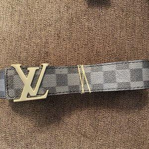 Louis Vuitton belt. Ferragamo belt.
